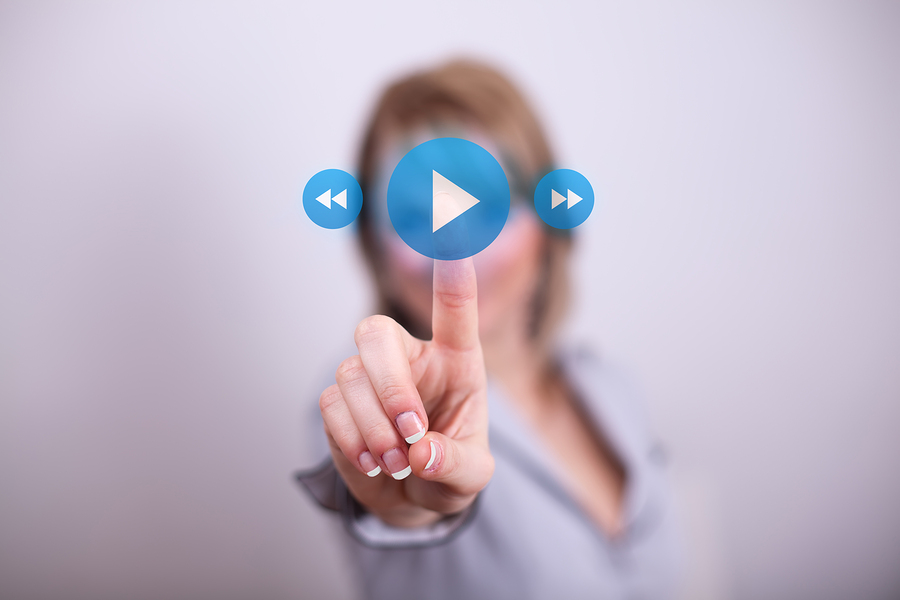woman pressing play button